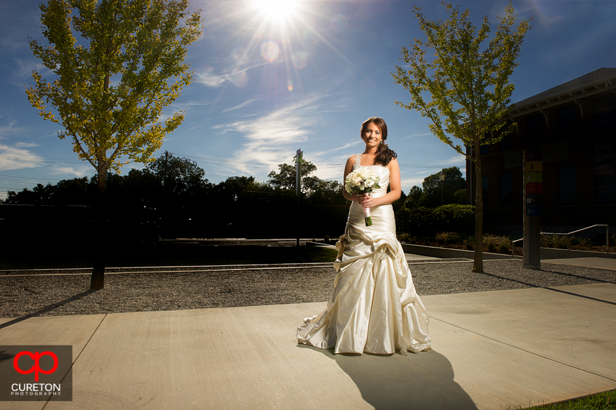 Bride with sn in background.