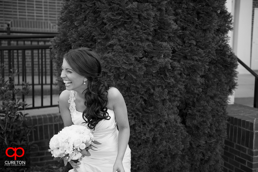 Bride laughing before ceremony .