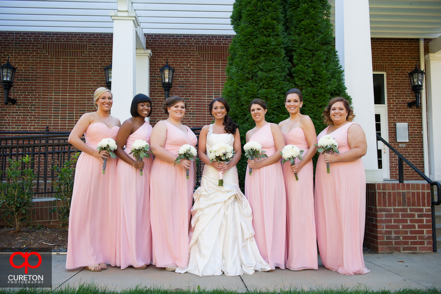 Bridesmaids outside of ceremony.