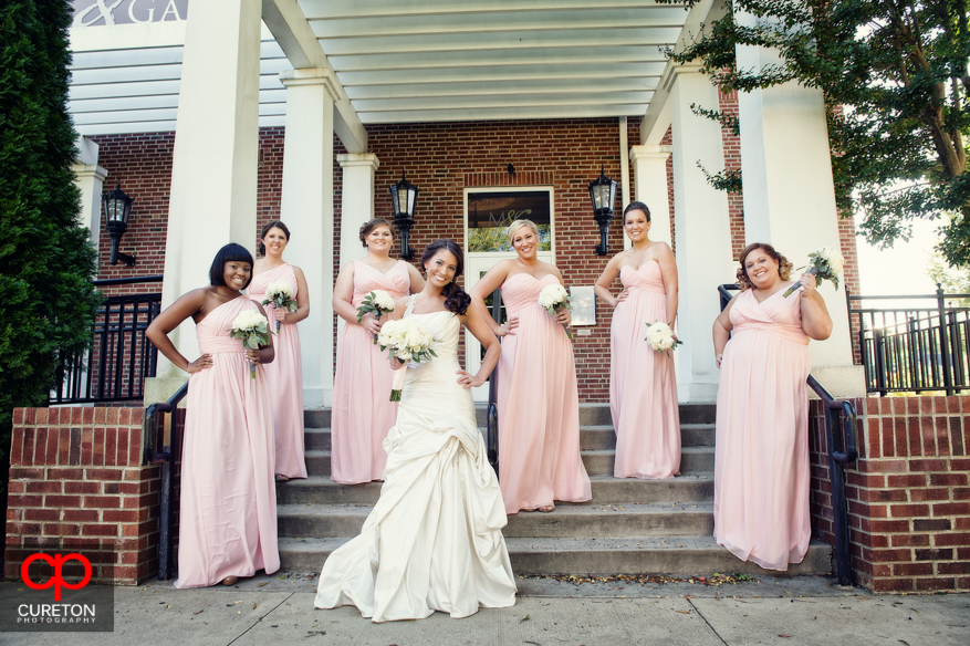 Bride and bridesmaids on the steps of Upcountry History Museum.