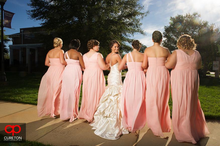 Bride and bridesmaids facing forward.