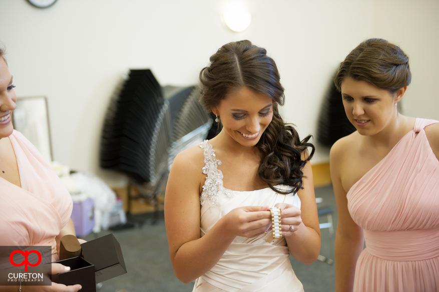 Bride receiving gift from groom.