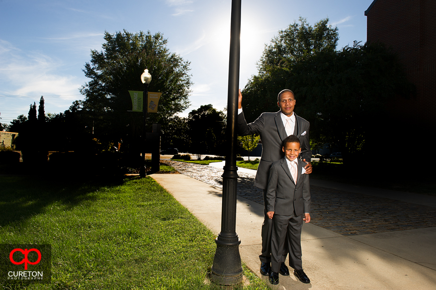 Groom standing with his son.