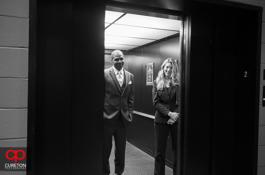 Groom in the elevator before hiswedding ceremony.