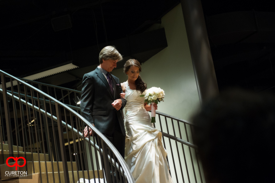 Bride and father walk down the aisle at Upcountry History Museum.