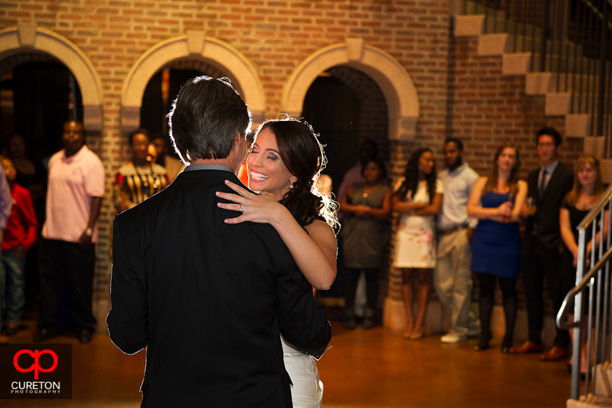 Bride dancing with her father .