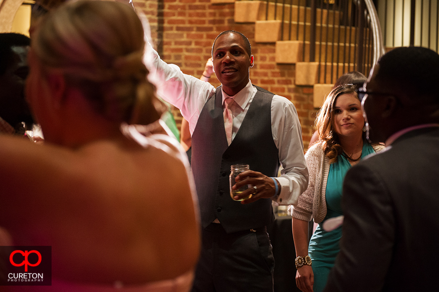 Groom enjoying the reception.