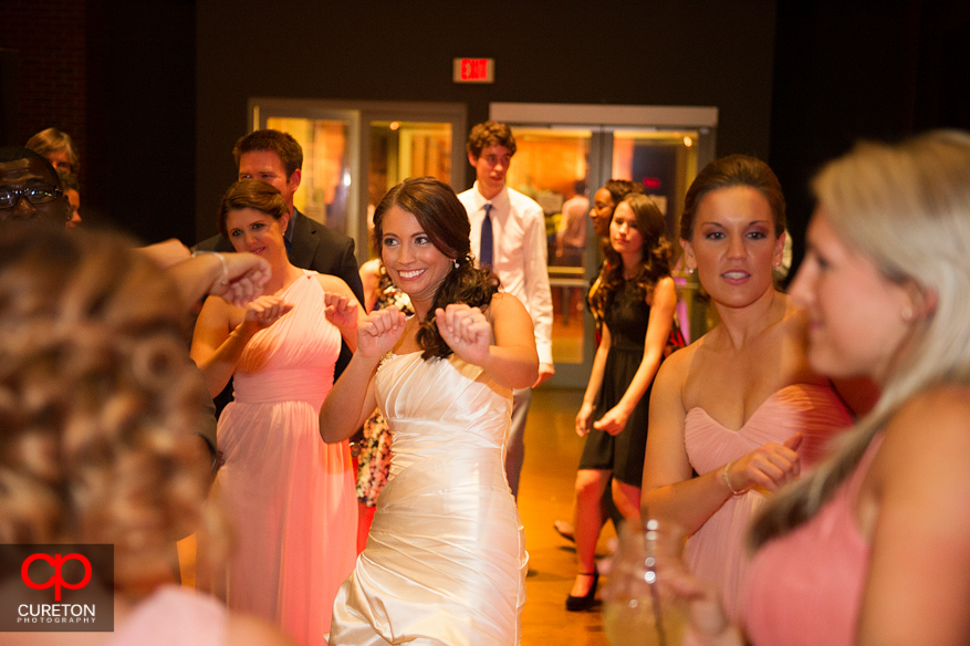 Bride dancing with her bridesmaids.