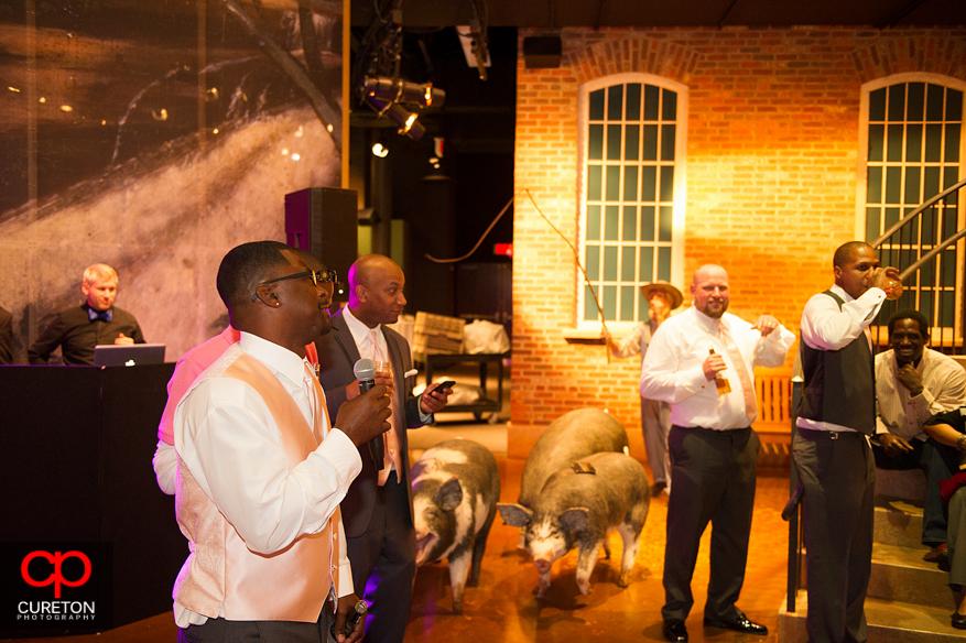 Groomsmen singing to the happy couple.