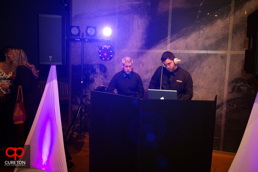 The guys from uptown entertainment behind the dj booth.