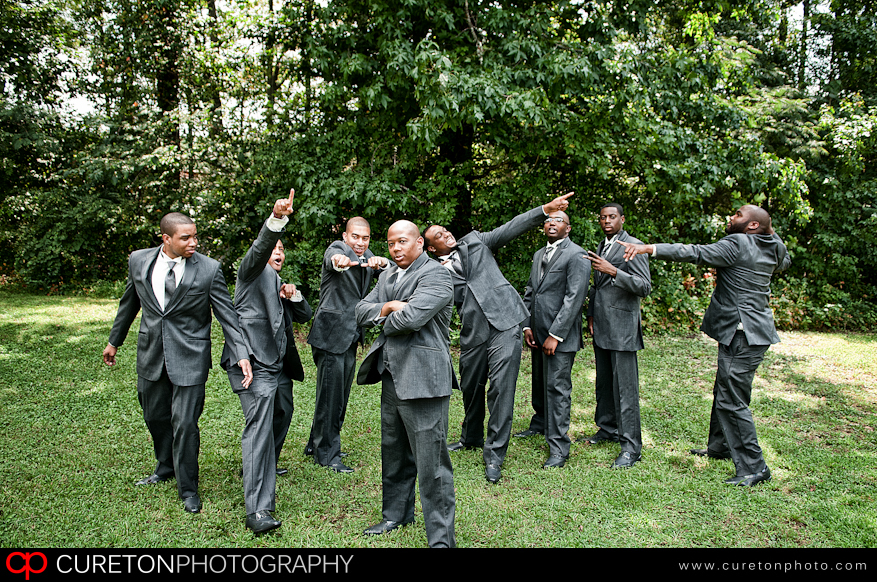 Casual shot of groomsmen with some doing the Usain Bolt pose.