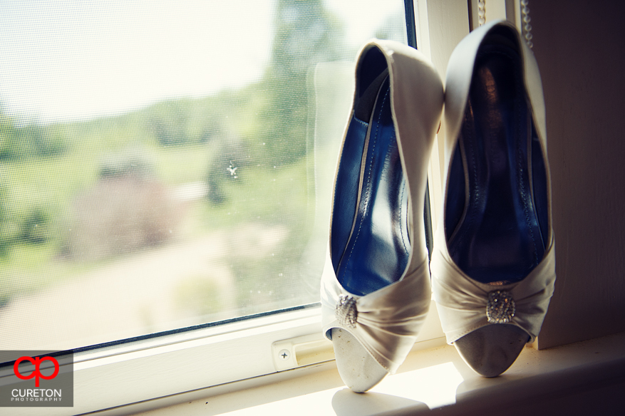 Brides shoes in a window sill.