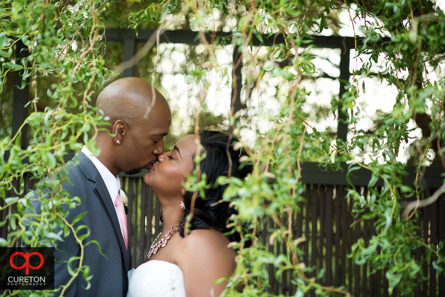 Bride and Groom kissing at Zen in downtown Greenville..