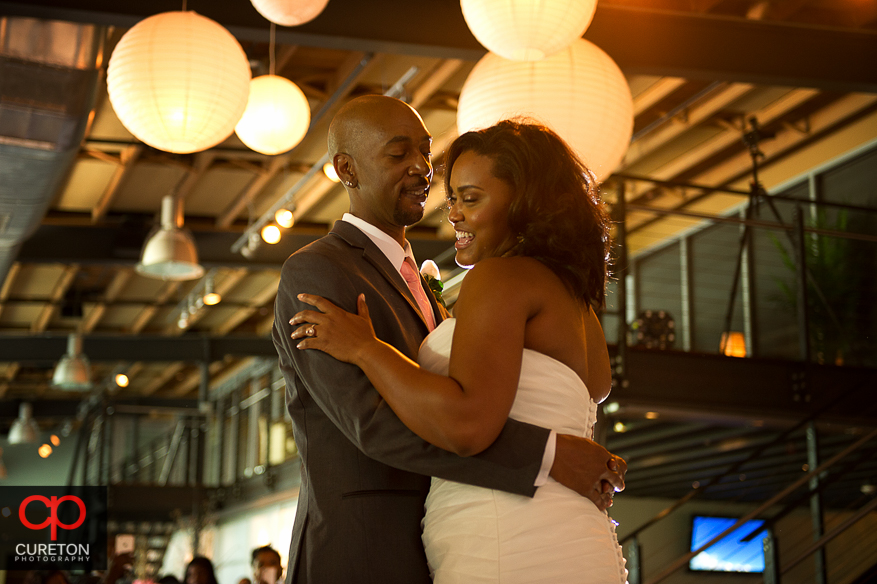 Bride and groom having their first dance at their reception at Zen in downtown Greenville.