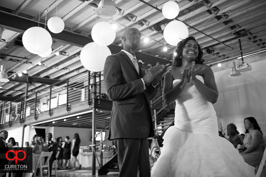Bride and groom laughing.