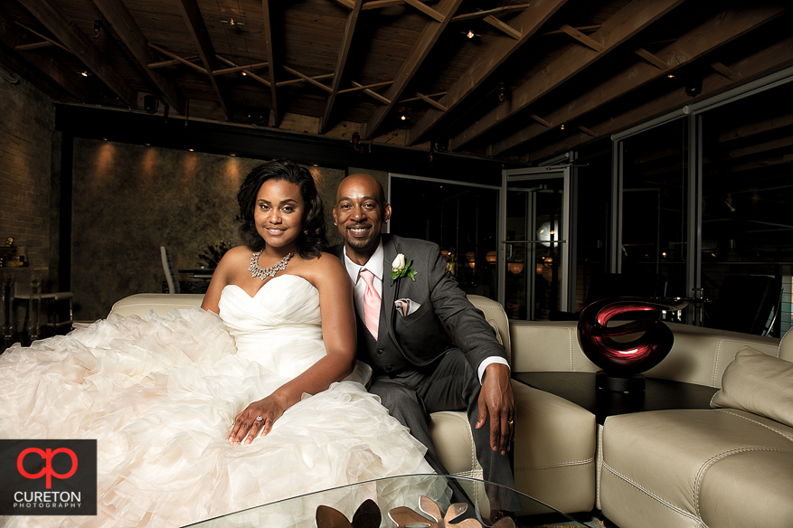 Bride and Groom relaxing in the loft after there reception at Zen in downtown Greenville..