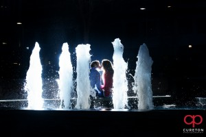Epic pre-wedding fountain photo during an engagement session in downtown Greenville,SC.