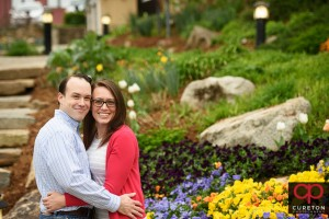 Engaged couple cuddling in downtown Greenville,SC.