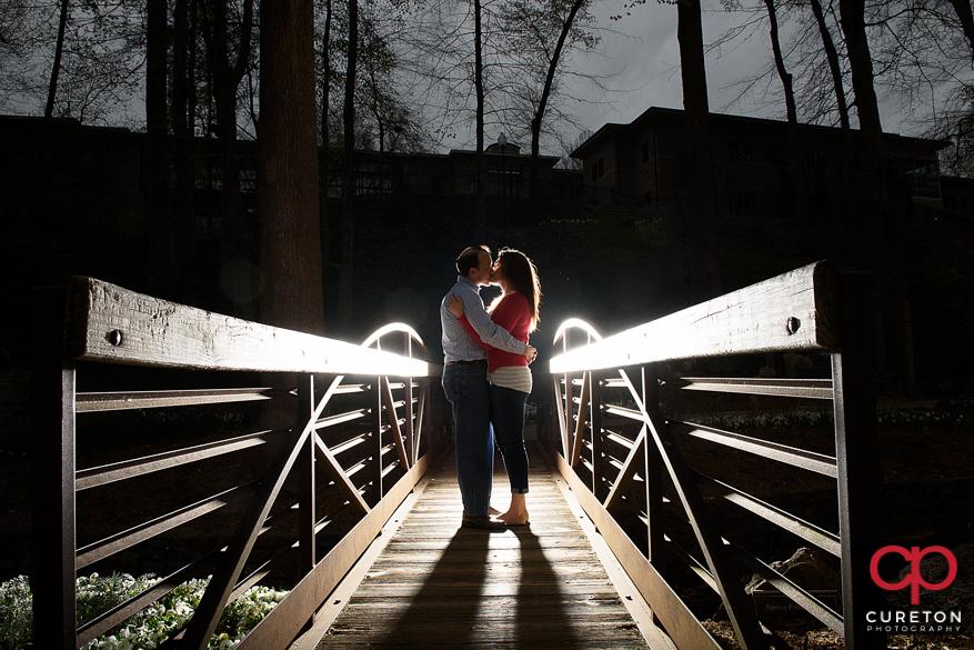 Backlit photo on the bridge in Falls PArk.