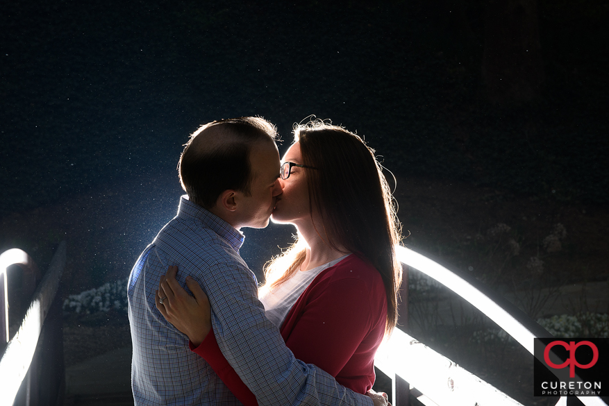 Epic engagement kiss photo in downtown Greenville,SC.