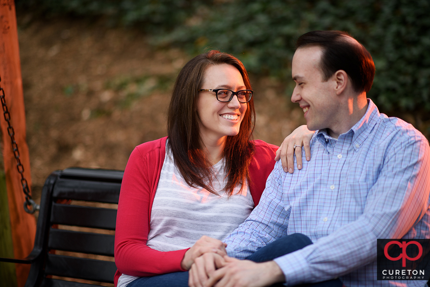 Couple sitting on a park bench.