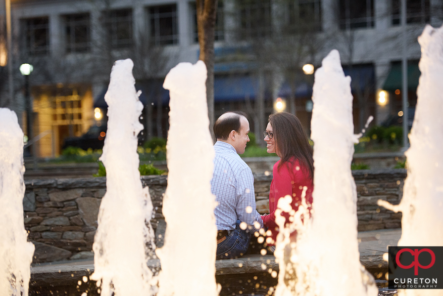 Couple during an engagement session along the Reedy River.