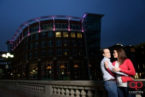 Creative nighttime engagement photo in downtown Greenville,SC.