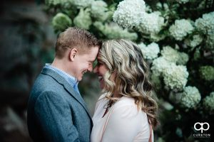 Engaged couple touching foreheads during their Rock Quarry Garden Engagement Session.