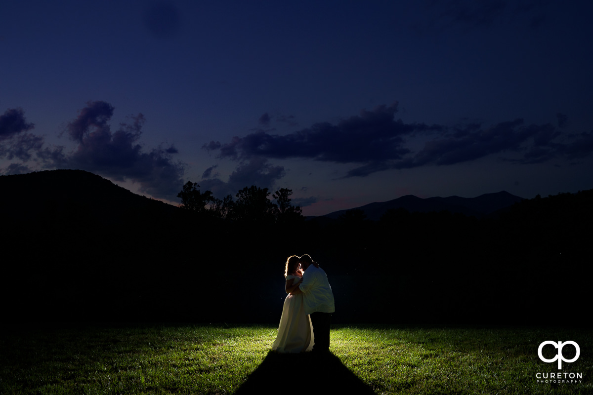 Bride and groom in front of a mountain overlook not far from the Blue Ridge Parkway after their Asheville NC outdoor wedding.
