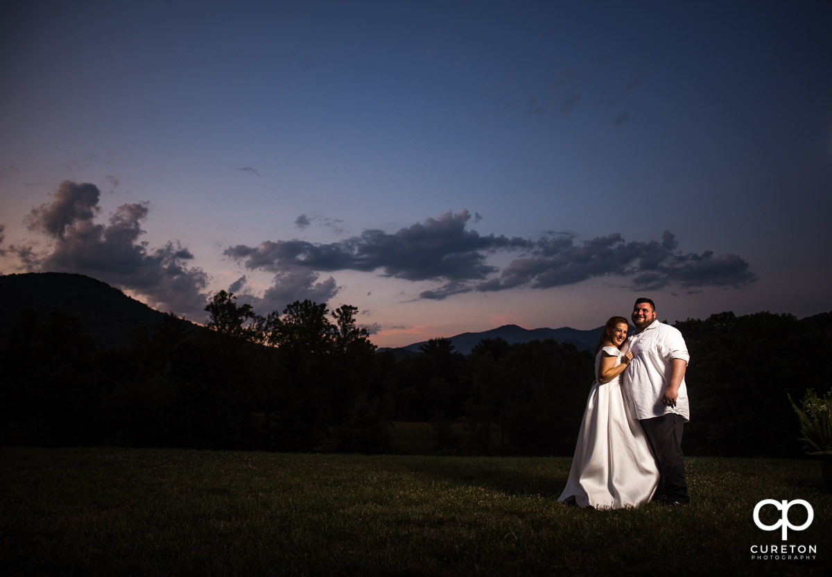 Bride and groom at sunset after their their Asheville NC outdoor wedding.