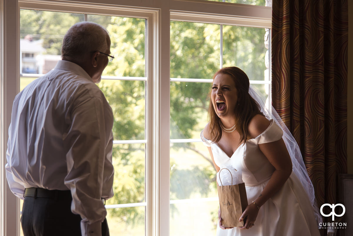 Bride and her dad see each other before the wedding.