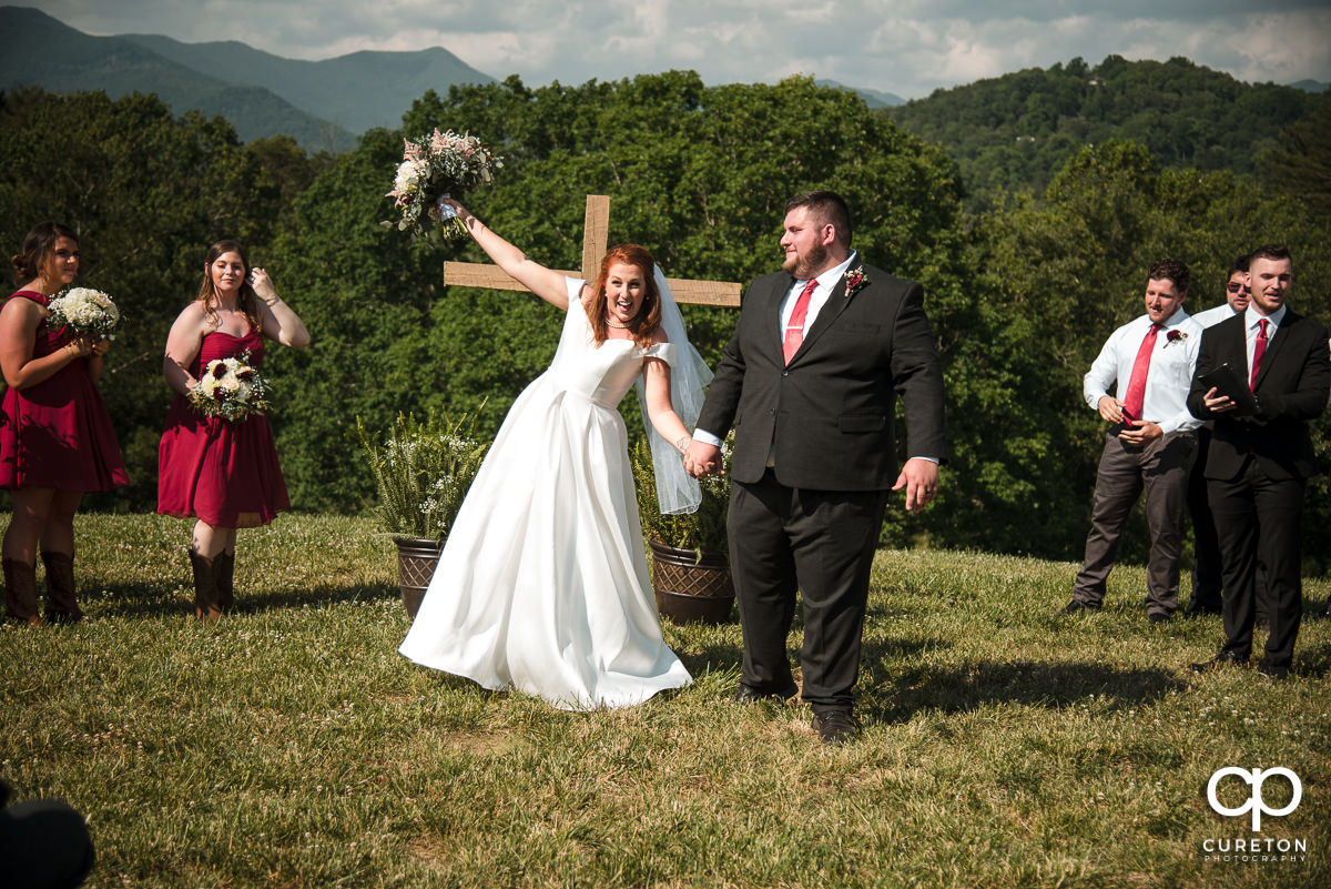Bride and groom walking back down the aisle during the outdoor wedding ceremony in Asheville,NC.