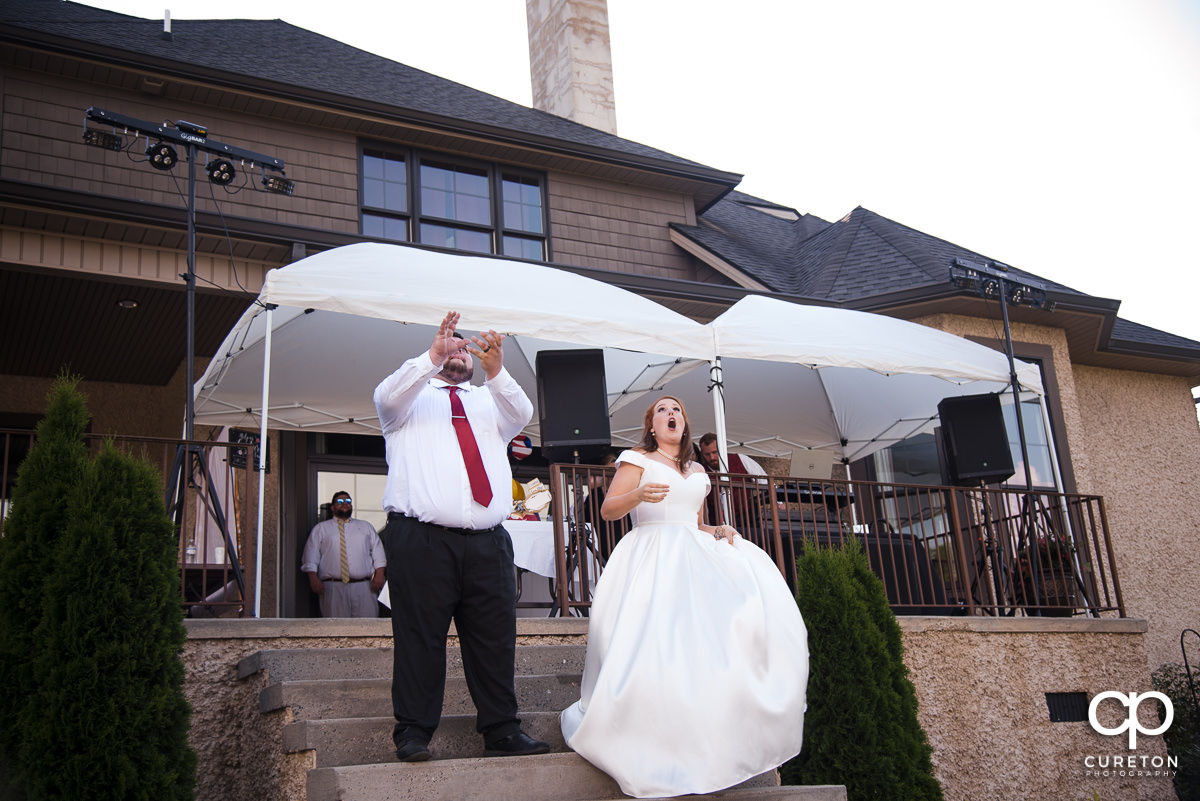 Bride and groom making a grand entrance to the reception.