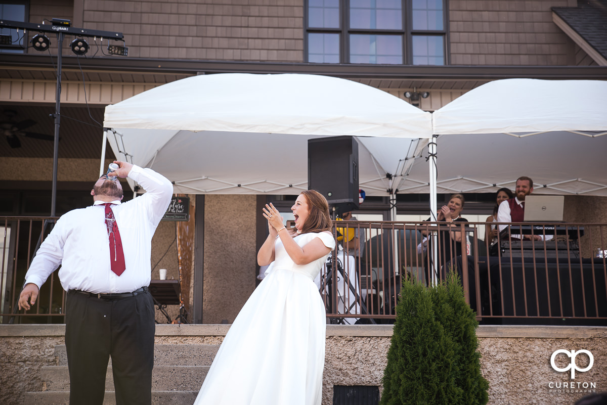 Groom chugging a beer as they are introduced.