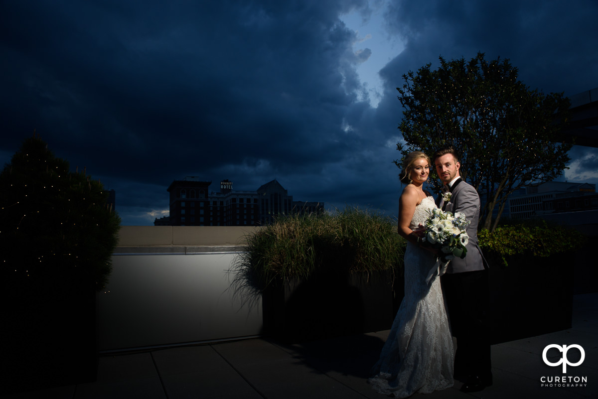 Bride and groom at blue hour after their rooftop wedding ceremony at Avenue in Greenville,SC.