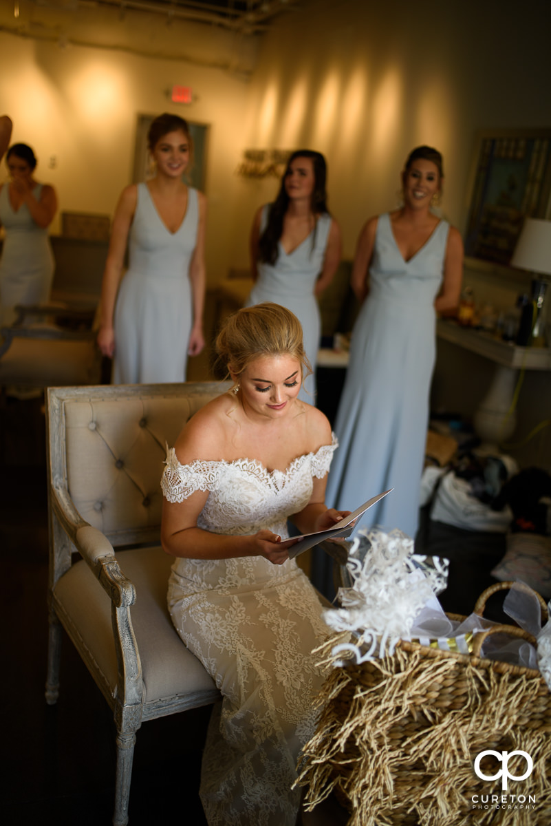 Bride reading a card from her mother.