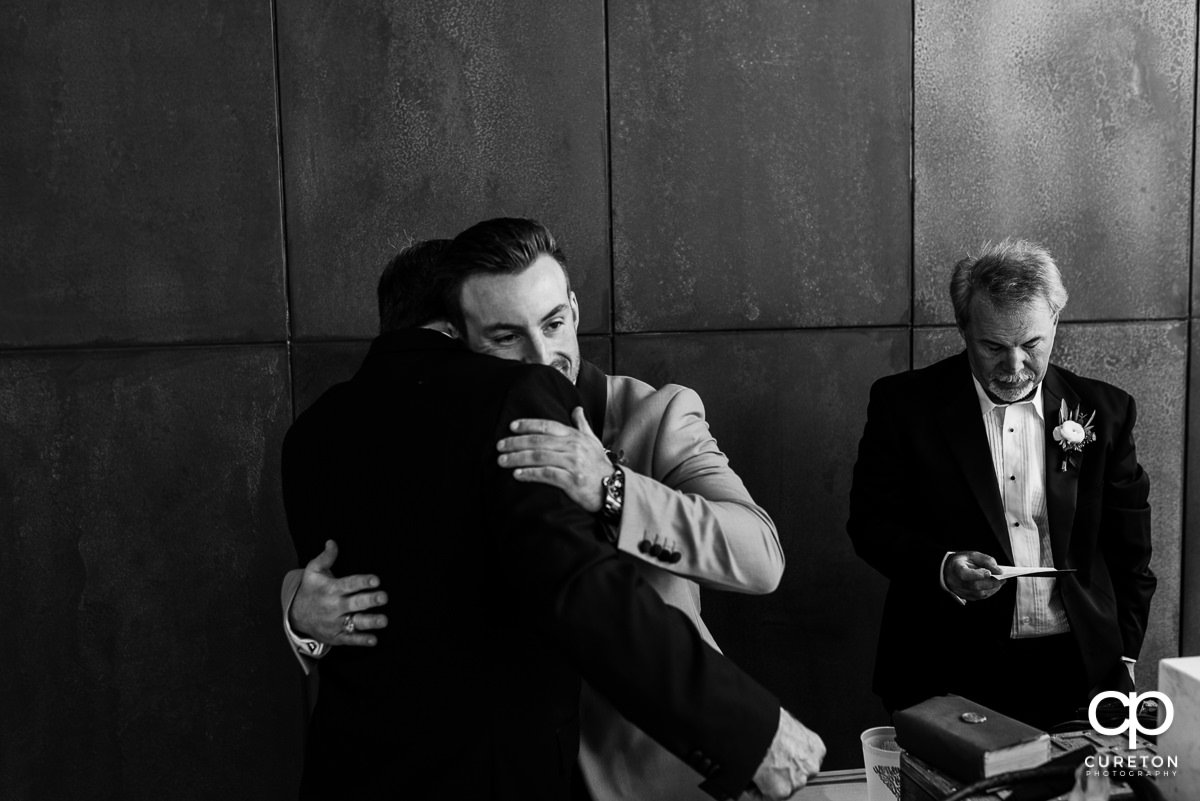 Groom hugging his father in law.