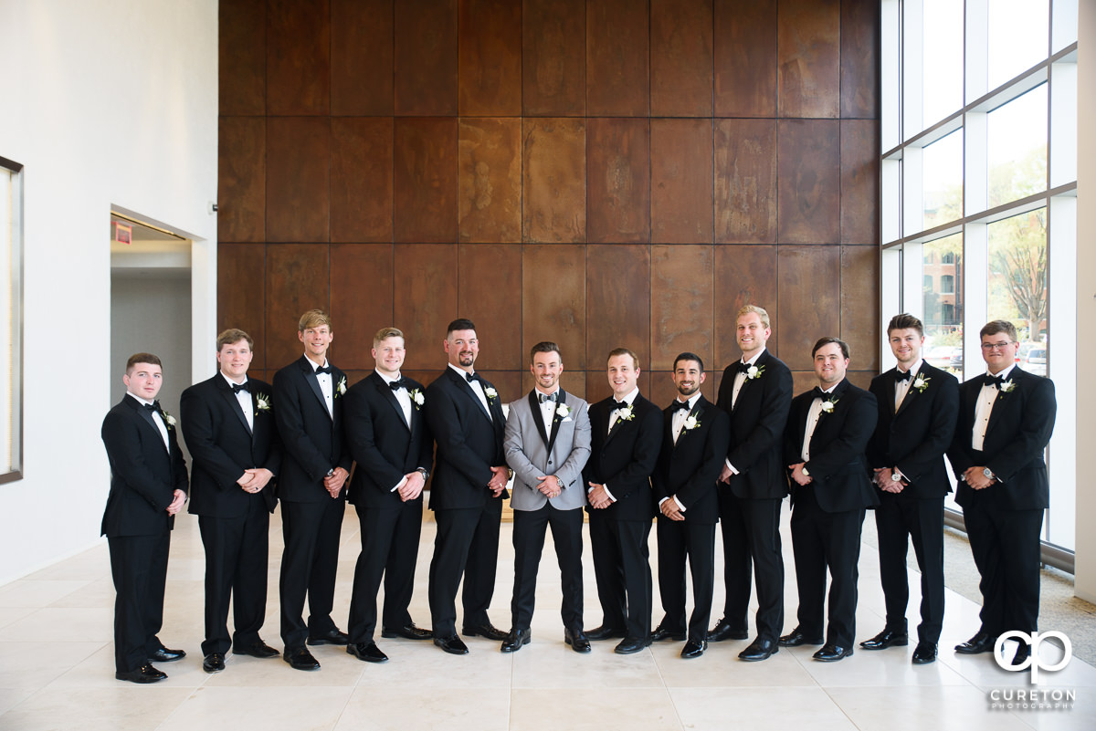 Groom and groomsmen in the lobby at Avenue.