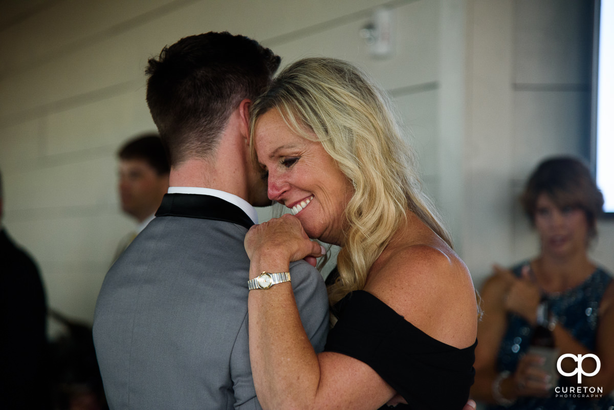 Groom's mom shared a dance at the wedding with her son.
