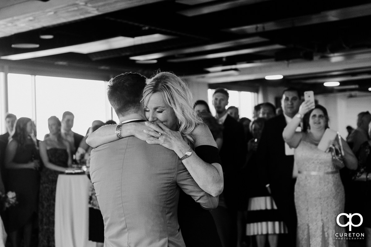 Groom hugging his mom after they shared a dance.