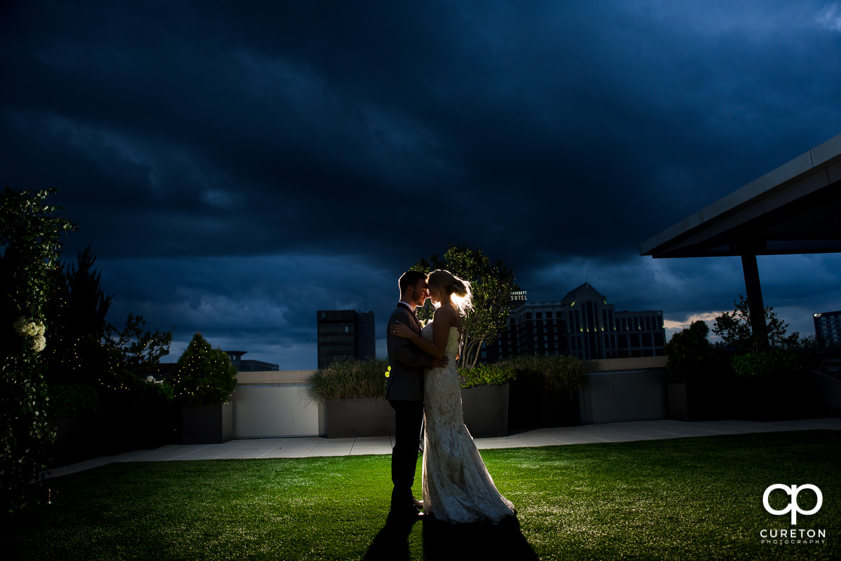 Bride and groom dancing on the astroturf on the rooftop at Avenue.