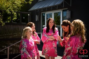 Bridesmaids in robes outside.