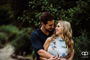 Engaged couple smiling at each other during their Botanical Gardens engagement session in Clemson,SC.