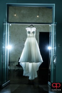 Bridal dress hanging in the window at Zen.