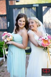 Bride posing with a bridesmaid.