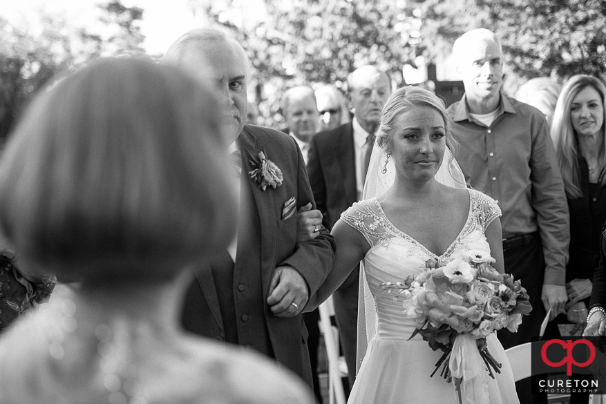 Bride getting emotional when she walks down the aisle.