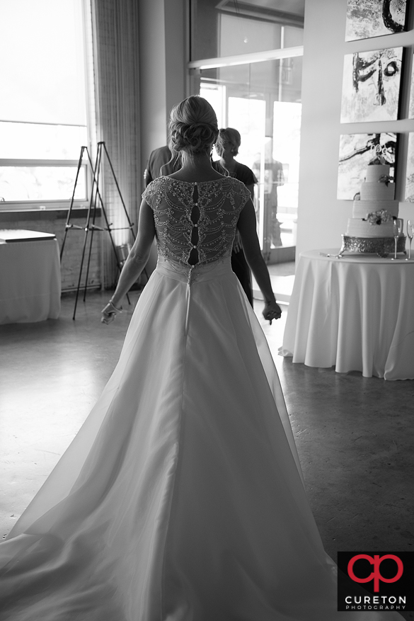 Bride walks toward her father for a first look.