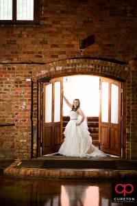 Bride standing in the doorway.
