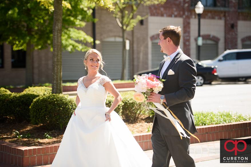 Bride and groom on main street Greenvile.