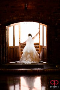 Bride standing in the doorway during her Old Cigar Warehouse bridal session.